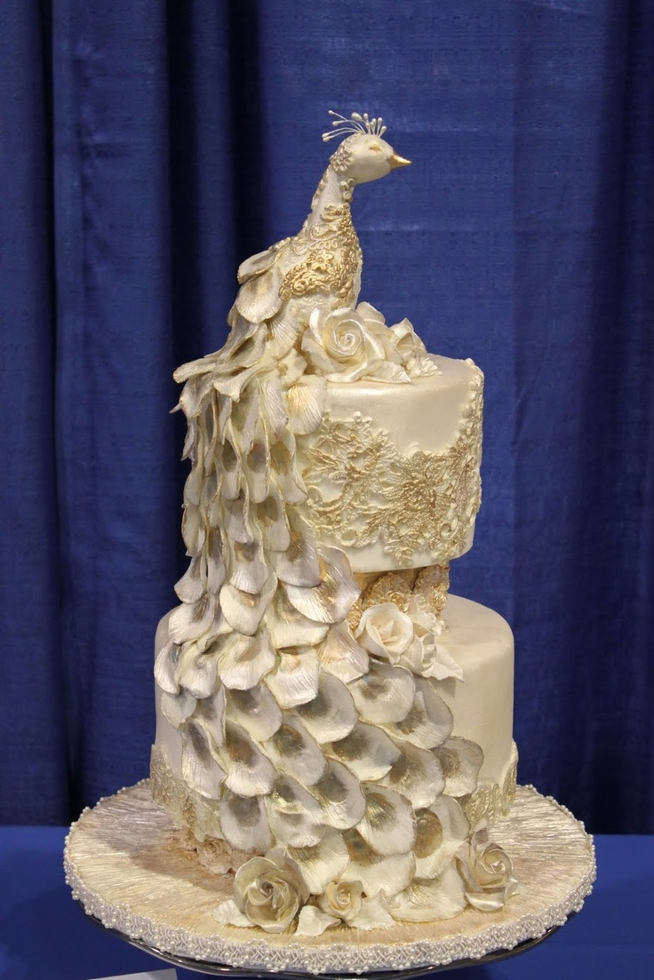 white and gold peacock wedding cake
