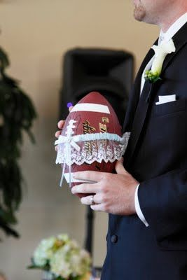 Football with Garter wrapped around it